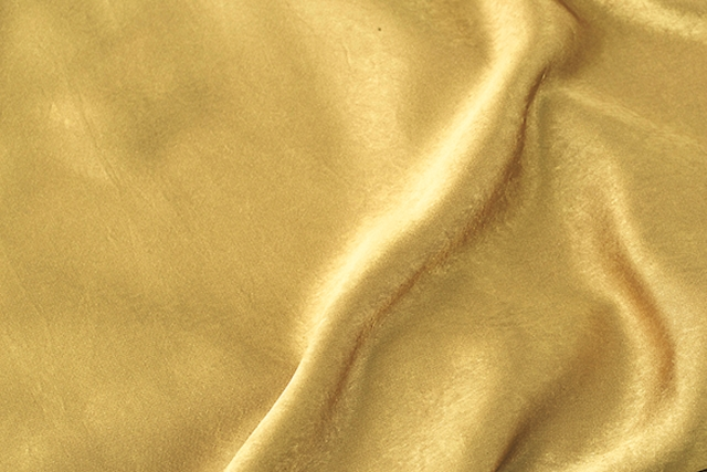 Debs Textile Corporation: The vintage processing of this double satin bestows a softness to the fabric's core, creating a draped and elegant touch with an exquisite shine (polyester 100%)